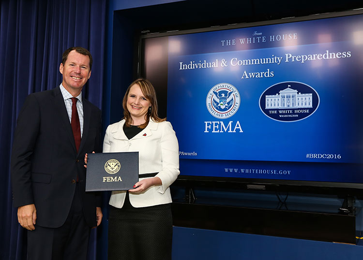 HSU Alumna Jenny Novak receiving an award from FEMA deputy administrator Tim Manning.