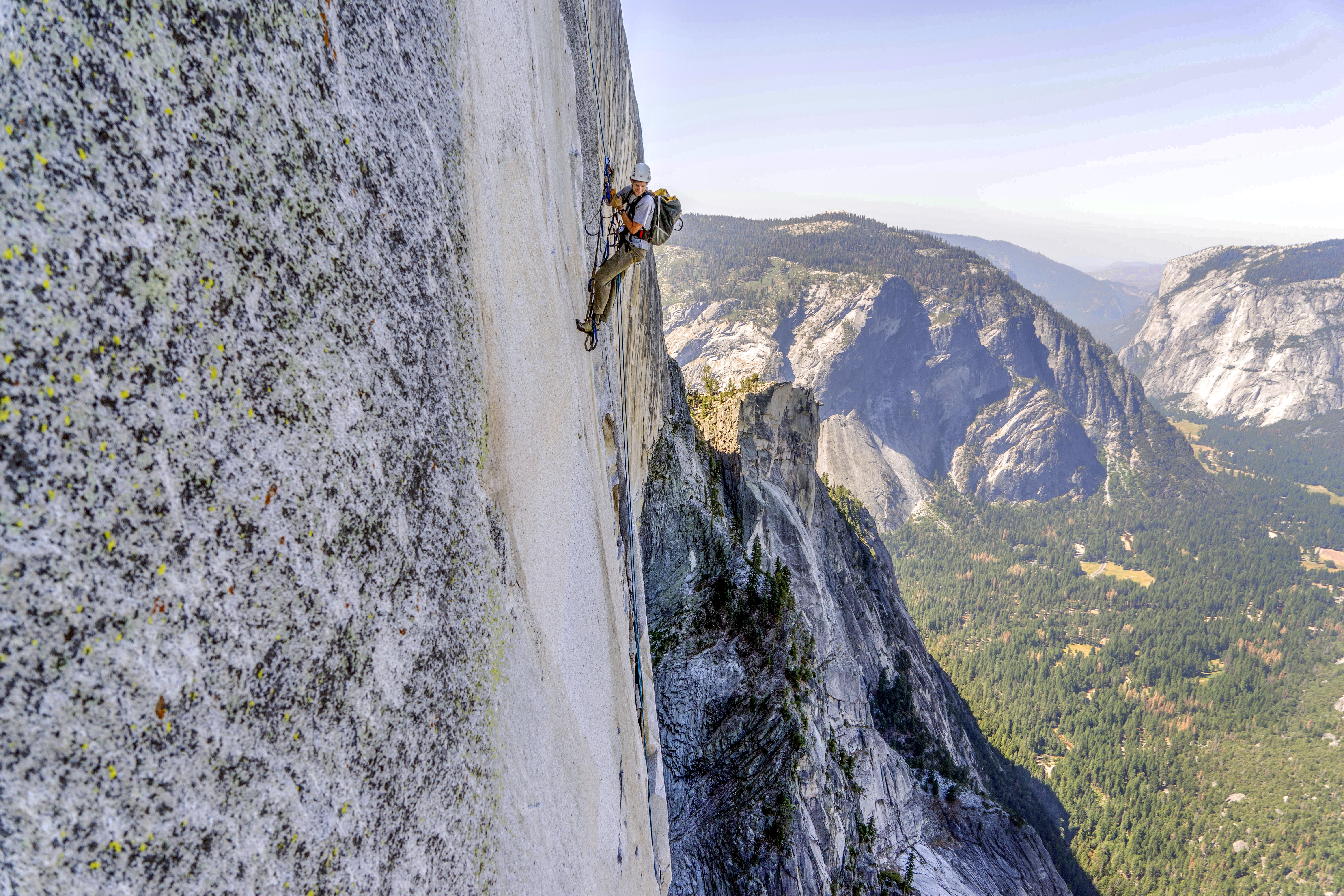 Stock ascends Half Dome in Yosemite National Park. As the official geologist of Yosemite National Park, Stock uses his rock climbing skills to assess rock formations for the safety of the park's four million annual visitors.